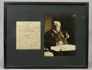 PHOTOGRAPH AND SIGNED MANUSCRIPT NOTE (1917), MATTED AND FRAMED