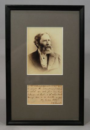 PHOTOGRAPH AND SIGNED MANUSCRIPT NOTE FRAGMENT, MATTED AND FRAMED